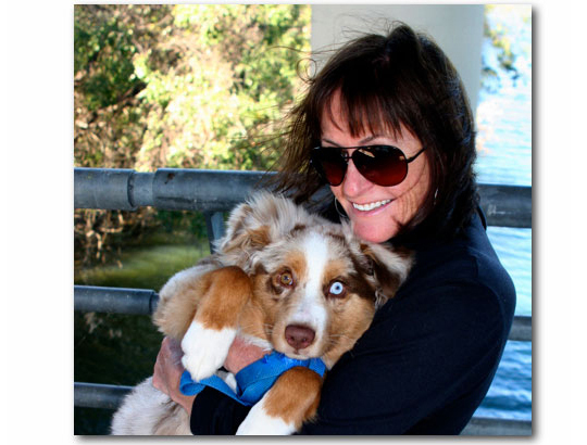 Photo of Paula Minahan holding Aussie pup Grady Tuck